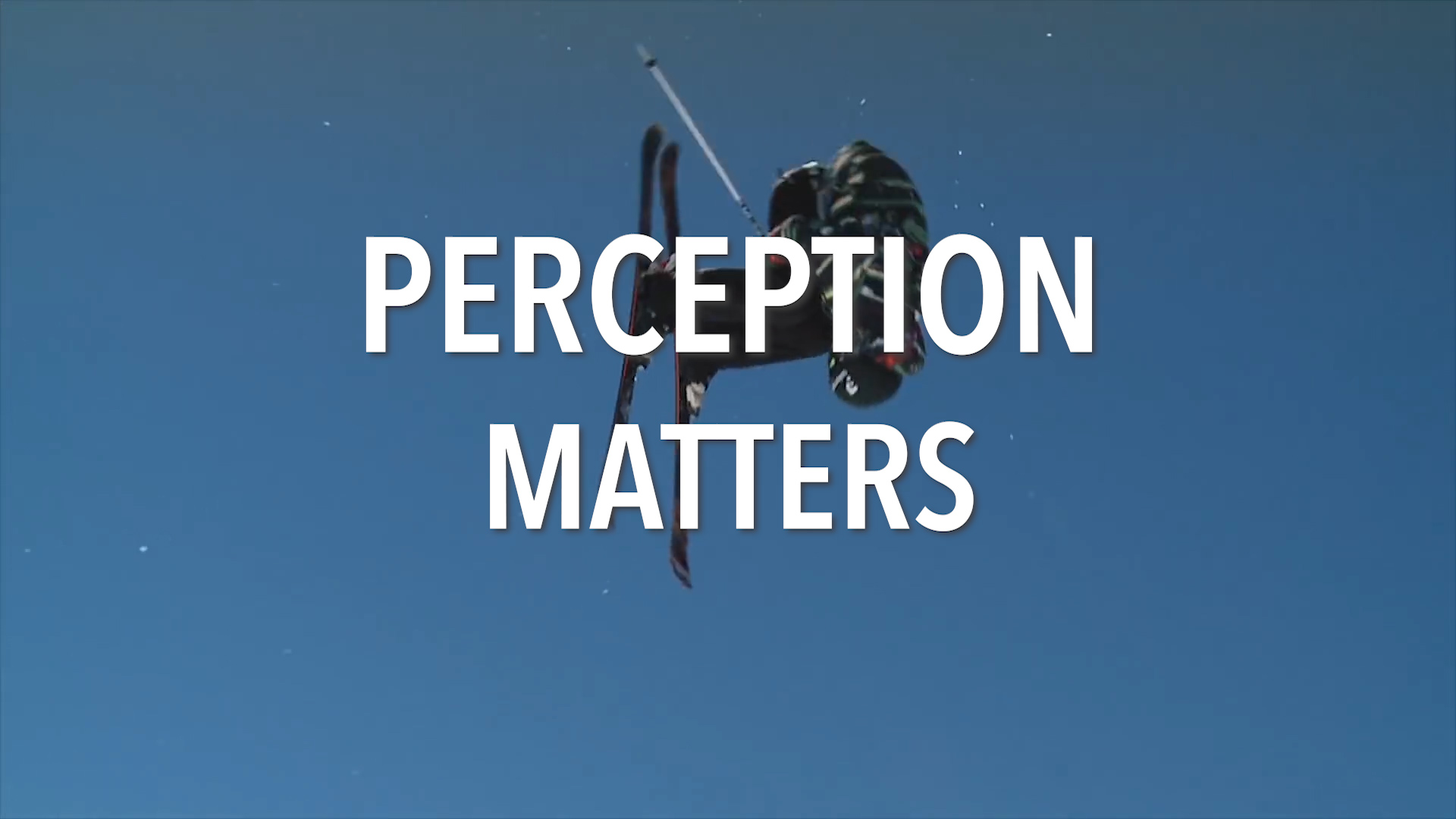 "skier flying through sky with ""Perception Matters"" written across"