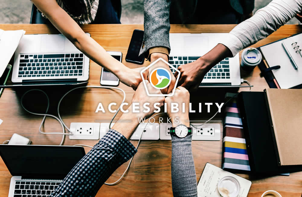 5 fists in with accessibility.works logo overlay