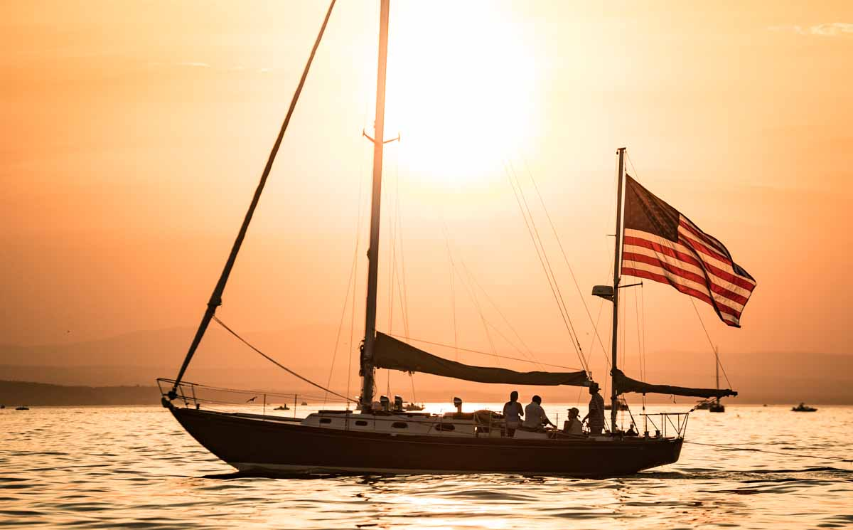 sailboat against orange sunset - metaphor for ADA website remediation providers