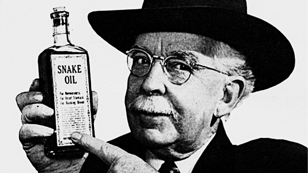 man in hat holding jar of snake oil