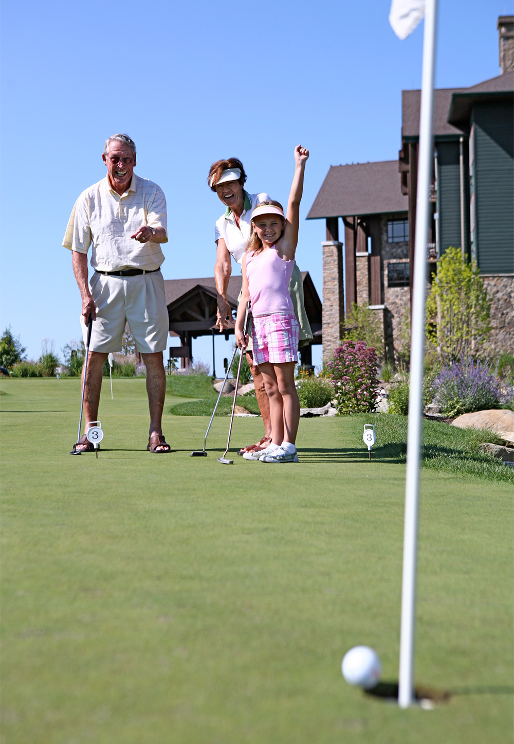 crystal spring family playing golf